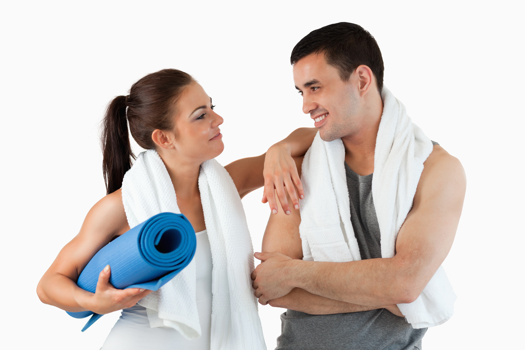 Healthy couple going to practice yoga against a white background